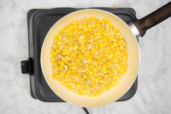 Corn added in hot oil.
