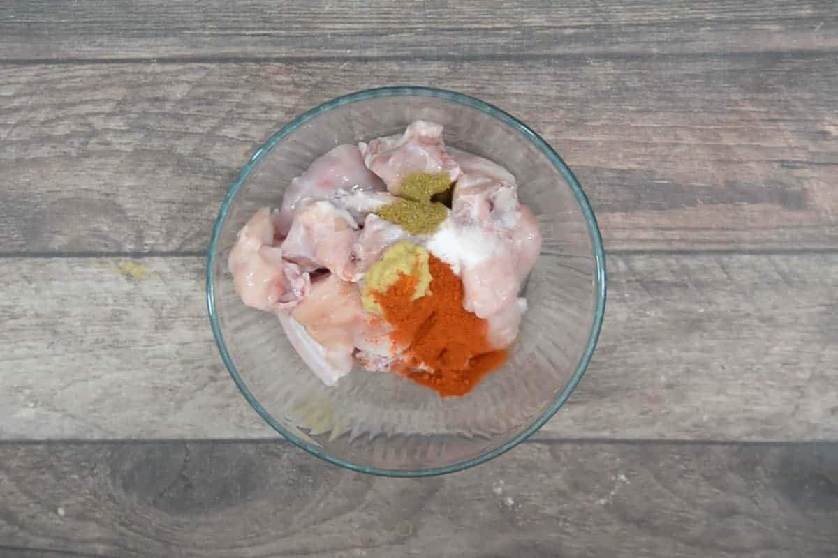 Marination ingredients added to a bowl.