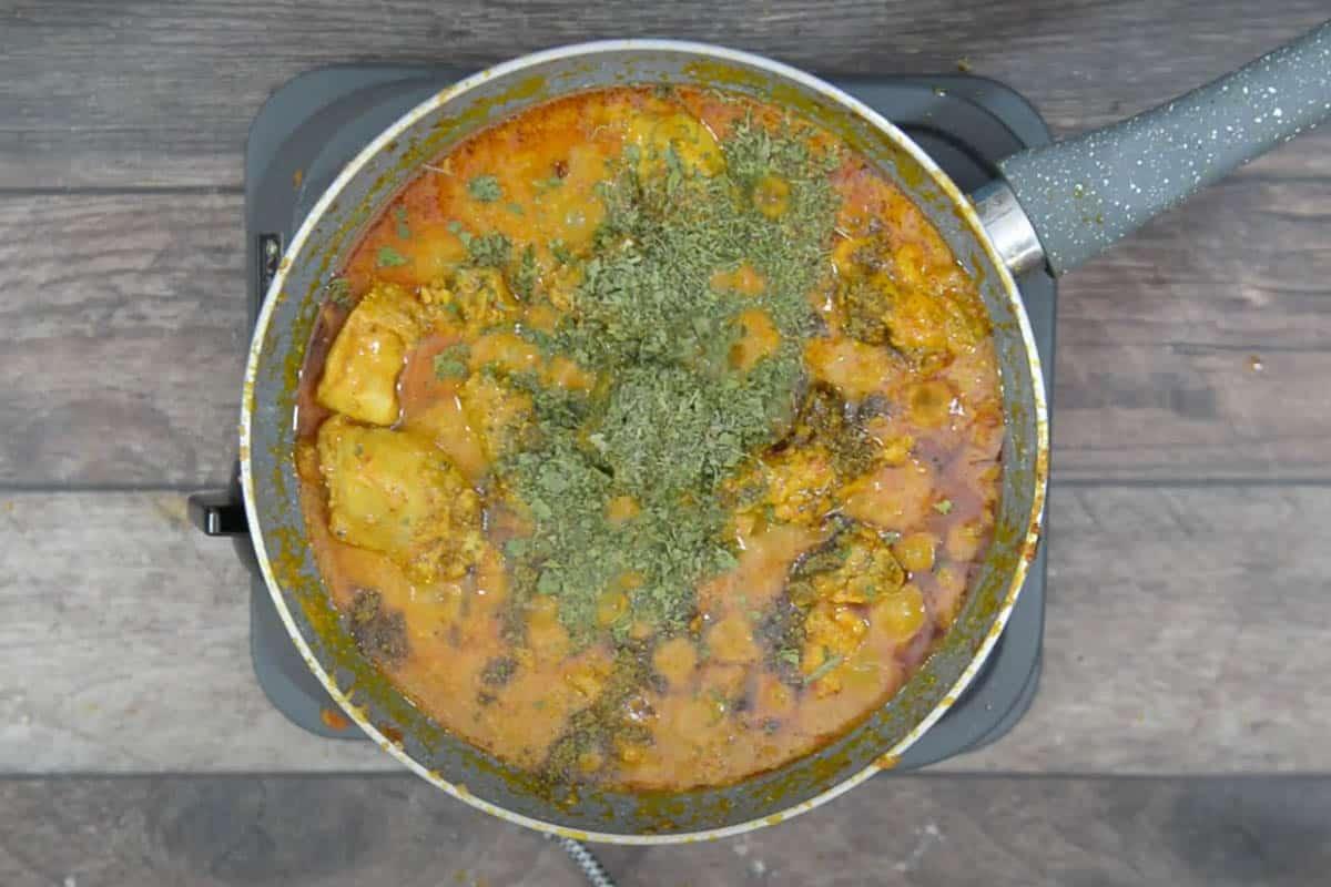 Garam masala powder and Kasuri methi added to the pan.