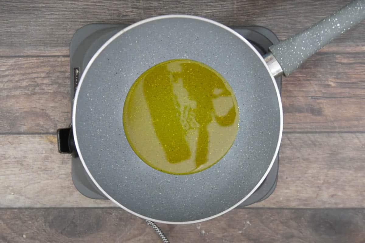 Mustard oil heating in a pan.