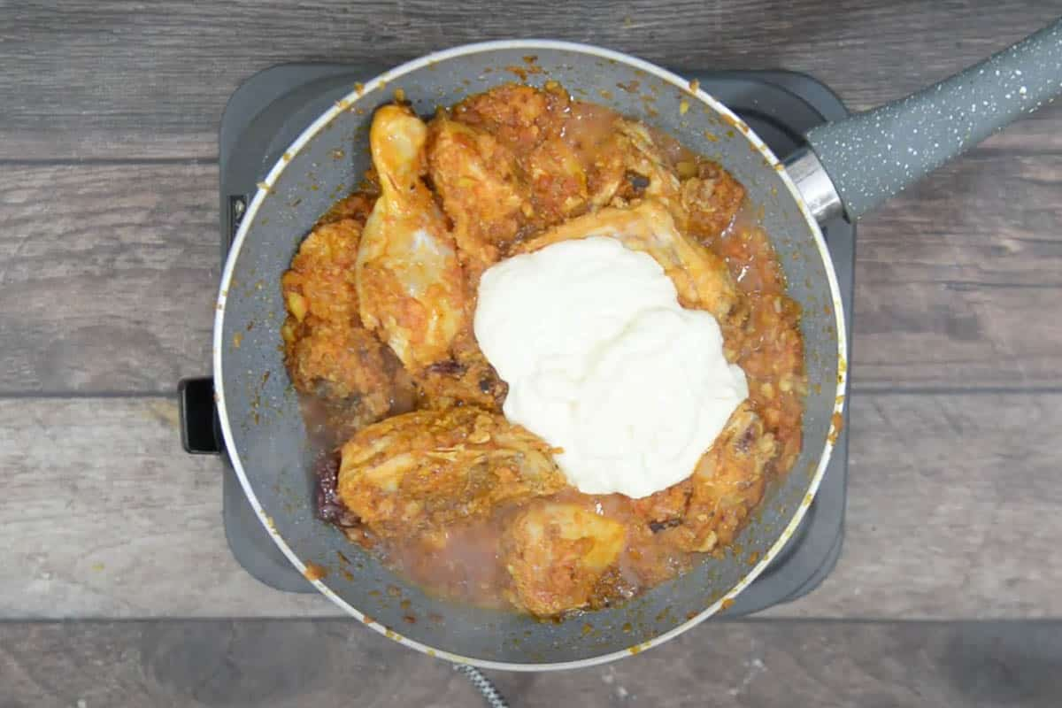 Yogurt added to the pan.