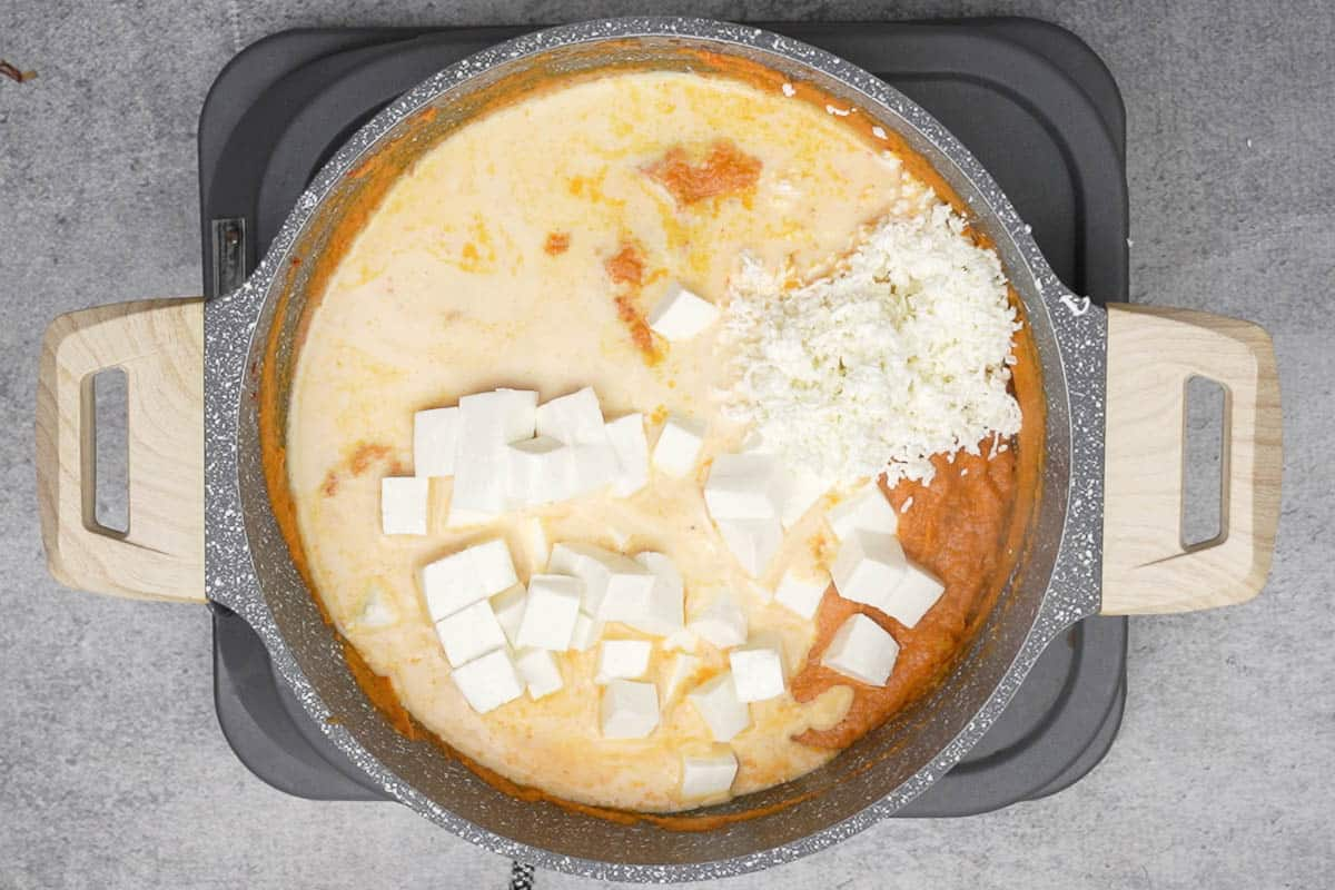 Paneer cubes, grated paneer and milk added to the pan.