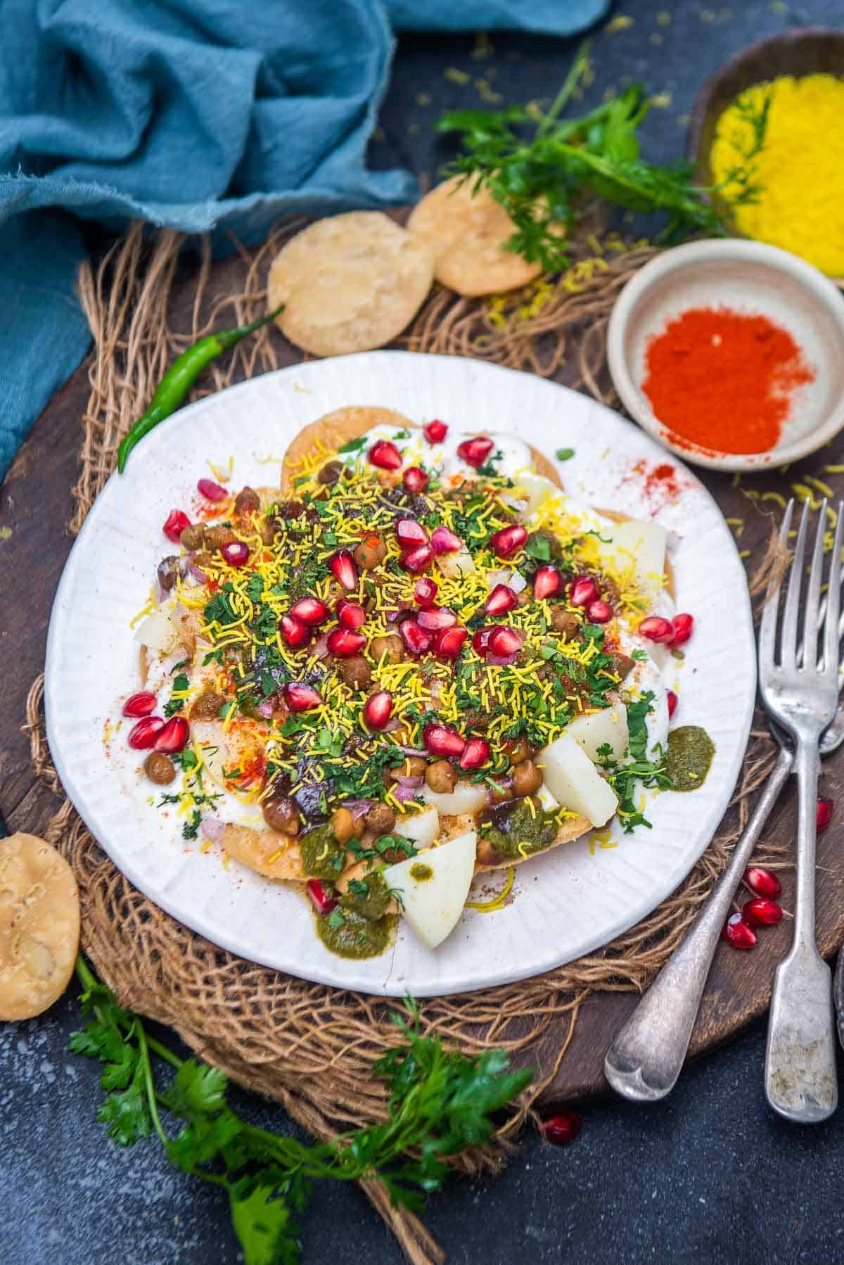 Papdi chaat served on a plate.