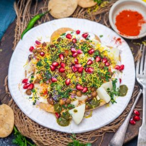 Make this sweet, spicy, and tangy papdi chaat at home using my simple recipe. This North Indian street food is everyone's favorite and is super easy to make.