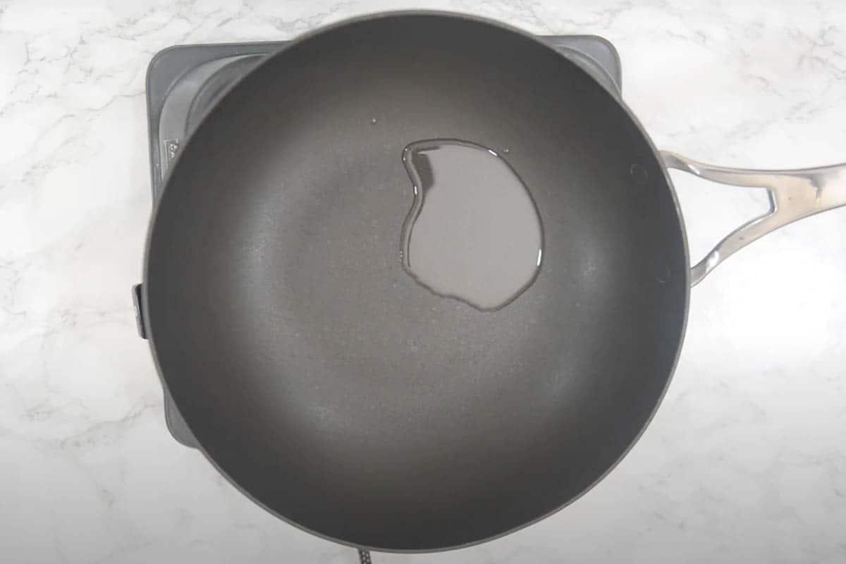 Oil heating in a wok.