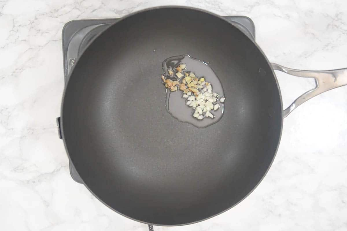 Ginger and garlic added to the wok.