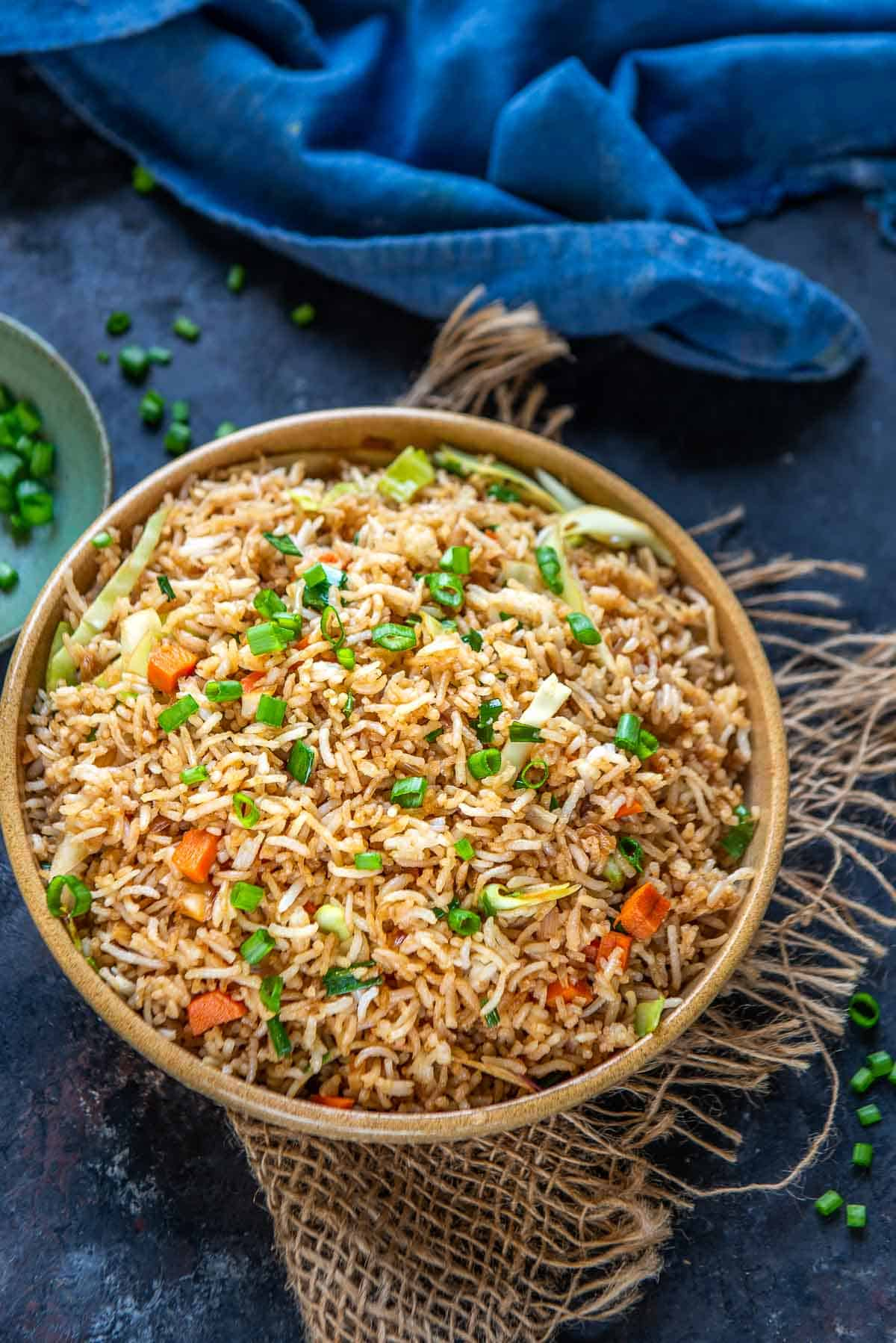 Vegetable fried rice served on a plate.