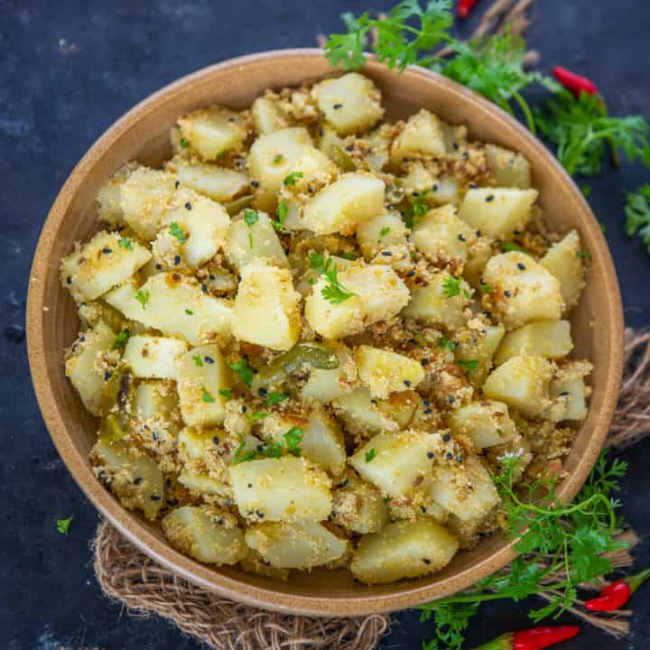 This authentic Bengali Aloo Posto is a perfect side to enjoy with Luchi or Dal Rice. The soft morsels of potatoes coated with a creamy poppy seeds coating with a hint of spice from green chilli is treat to the taste buds.