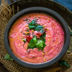 Beetroot Raita has this beautiful mix of nicely roasted, tender beetroot pieces which are assembled together with fresh curd, crushed peanuts. To retain the simplicity of this humble accompaniment, it is seasoned with the tadka of mustard seeds, curry leaves, dry red chillies, which completely enhances the taste of this desi dip. Here is how to make it.
