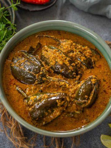 Bharli vangi is Maharashtrian-style stuffed brinjal. Make this traditional dish at home using my easy recipe.