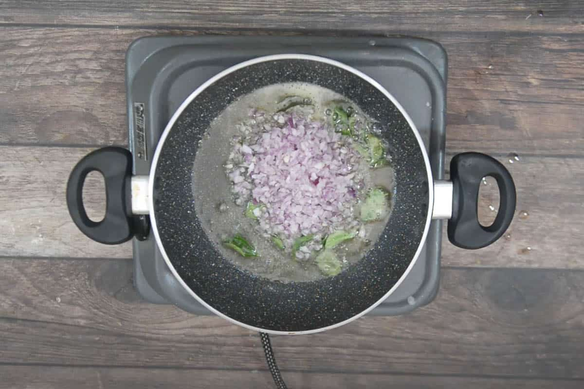 Finely chopped onion added to the pan.
