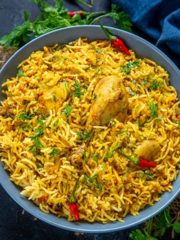 This One Pot Chicken Pulao or Chicken Tahari is a finger-licking spicy dish made keeping in mind the satiating blend of chicken, tomatoes, and aromatic basmati rice. This dish is perfect for a quick meal where everything is put into one pan and the result is a delicious flavourful Pulao.