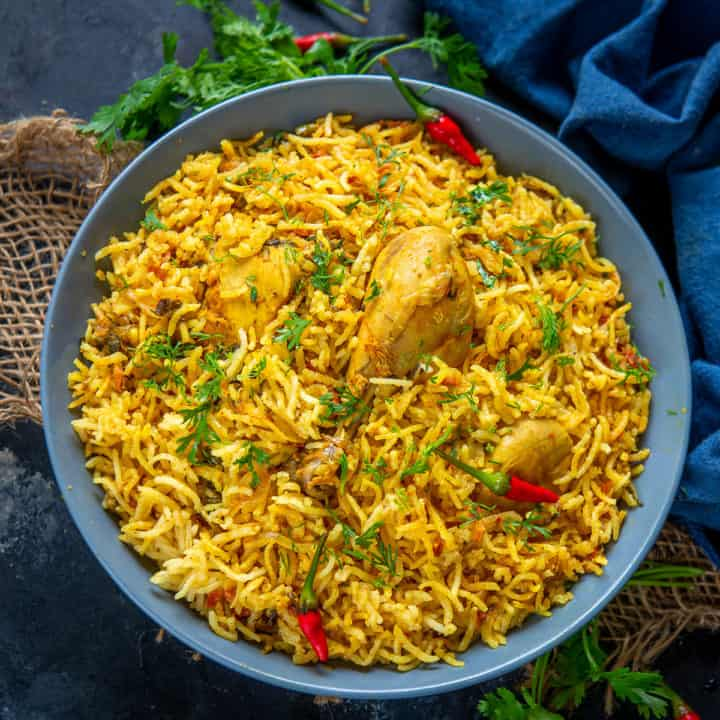 This One Pot Chicken Pulao or Chicken Tahariis a finger-licking spicy dish made keeping in mind the satiating blend of chicken, tomatoes, and aromatic basmati rice. This dish is perfect for a quick meal where everything is put into one pan and the result is a delicious flavourful Pulao.