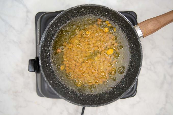 Peanuts frying in oil.