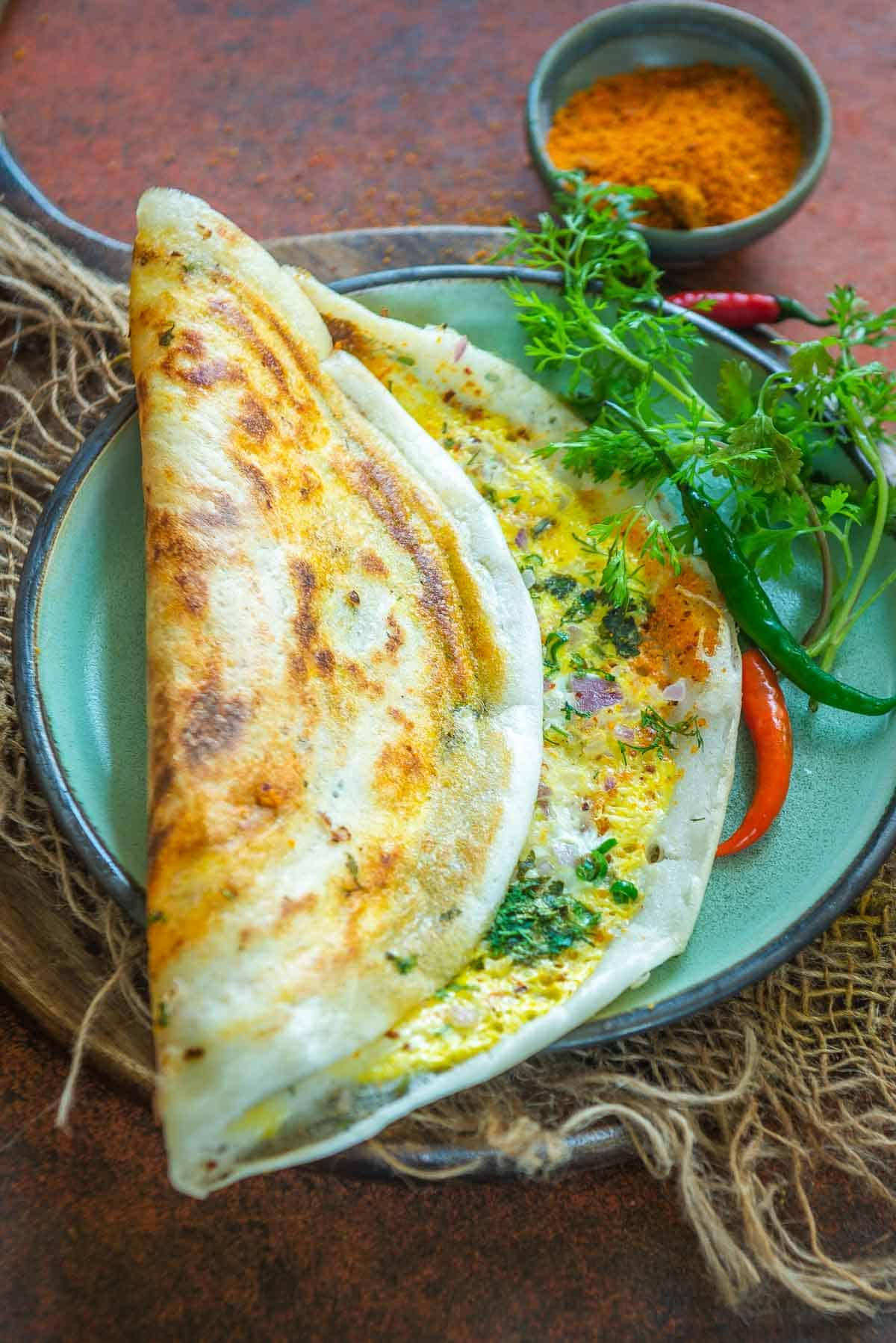 Egg Dosa served on a plate.