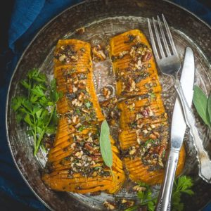 Looking for a stunning centre piece dish to make this festive season? This Roasted Hasselback Butternut Squash slathered with a honey mustard glaze is the just the one you want. Make it using this easy recipe and impress your friends and family. Here is how to make Hasselback Butternut Squash.