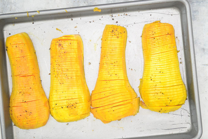 Cut squash placed on the baking tray.