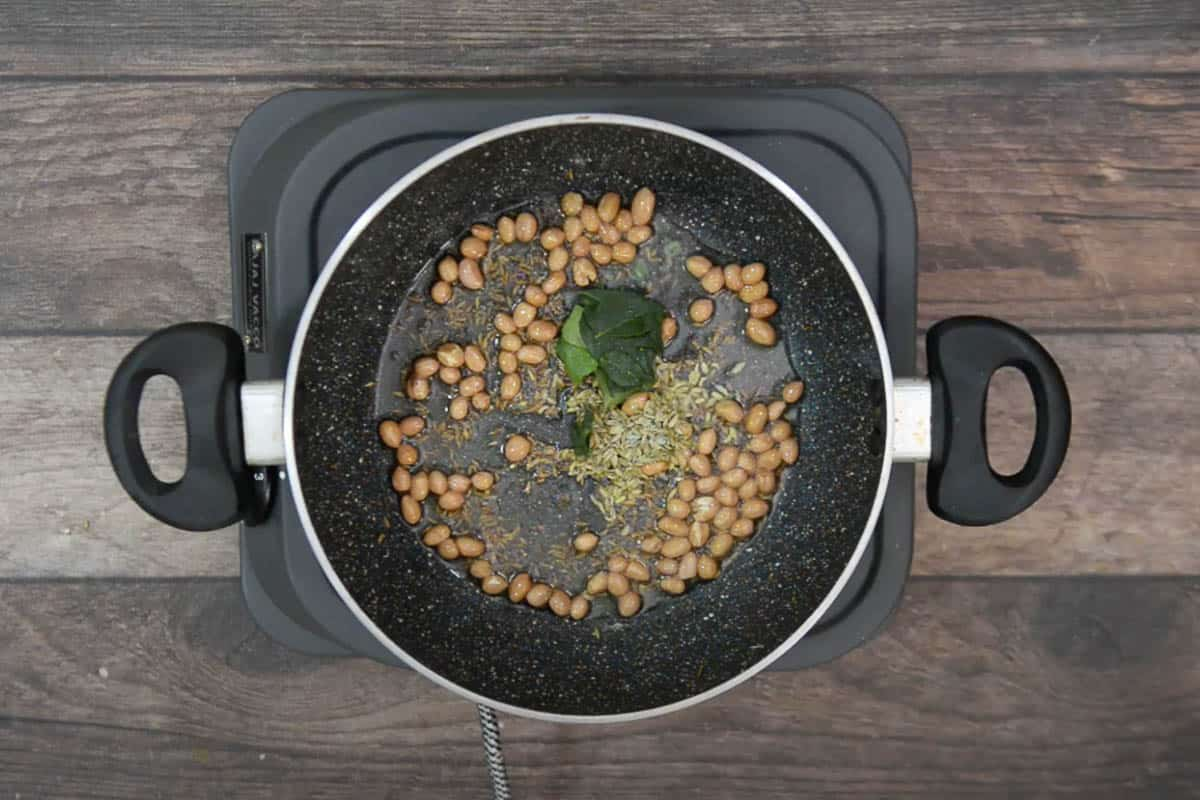 Fennel seeds and curry leaves added to the pan.