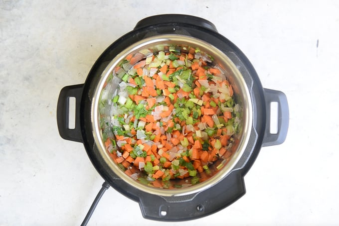 Carrot and celery added in the pan.