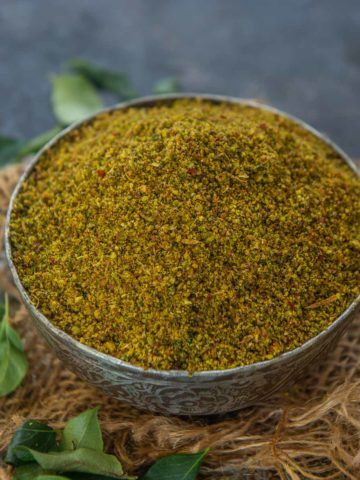 Karivepaku Podi or Curry Leaf Powder brings together a refreshing flavor of curry leaves, spices and it is ideal to be served with a bowl of rice or with idlis. Here is how to make it.