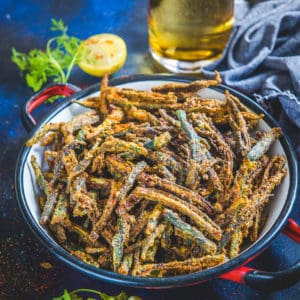 This Punjabi Kurkuri Bhindi, Bhindi Kurkuri or Crispy Okra is a spicy fried snack or main course dish made using Okra, gram flour and spices. It is very irresistible and can be prepared in minutes. Here is how to make it.