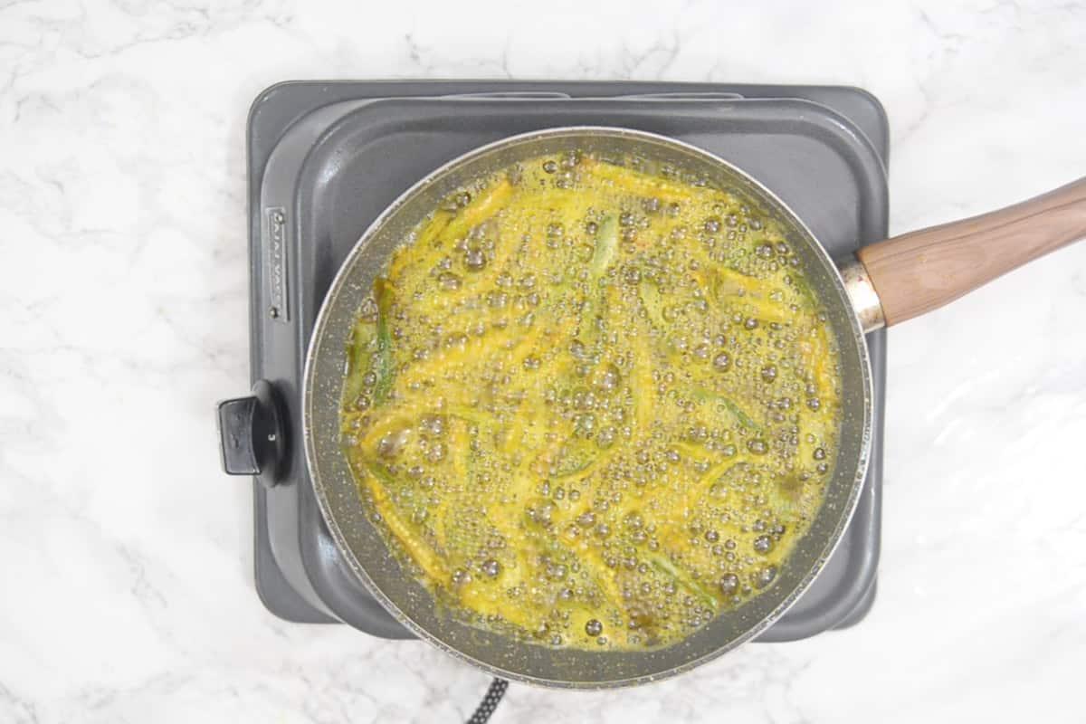 Bhindi added in hot oil.