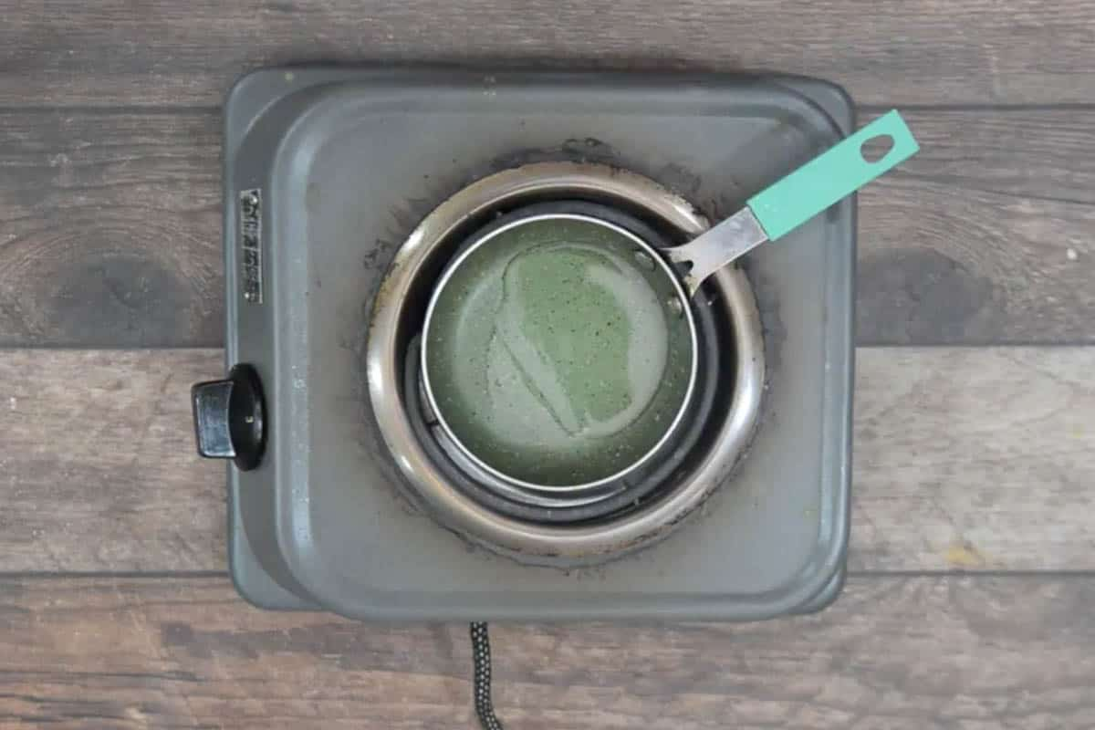 Coconut oil heating in a pan.