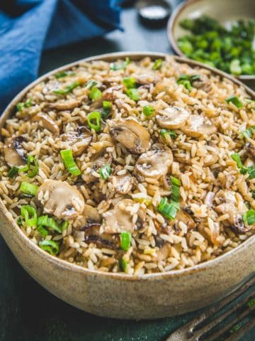 Make this delicious Indo Chinese Mushroom Fried Rice using the leftover rice in under 15 minutes. This recipe is vegan too.