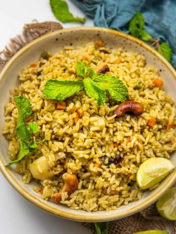 Pudina rice (mint rice) is a delicious one-pot South Indian recipe made using rice, mint, veggies, and a few spices. Serve it with raita for a comforting meal.