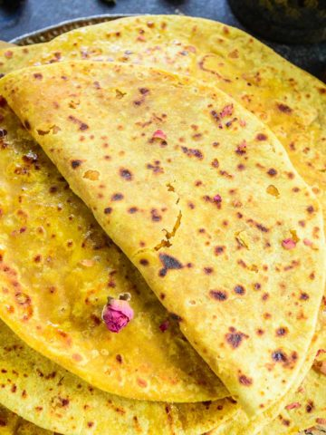 Puran poli or pooran poli is a traditional Indian sweet (Maharashtrian) made using whole wheat flour dough stuffed with a sweet lentil filling. Serve it with a dollop of ghee and milk on the side for a delicious breakfast, snack, or dessert.