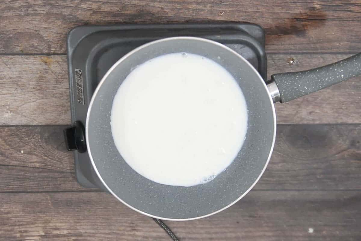 Milk added to a pan.