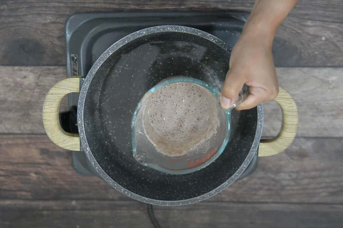 Ragi flour mixed in water added to the pot.