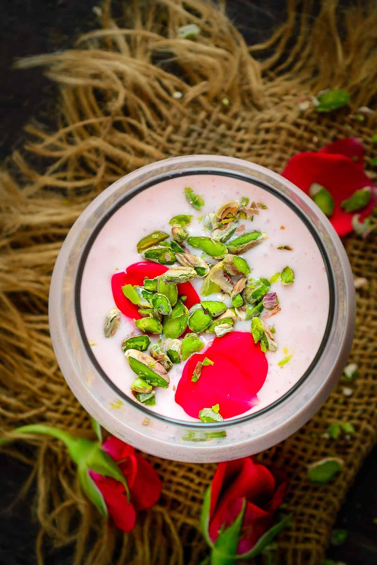 Rose lassi served in a glass.