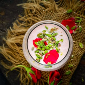 A delicious twist on the traditional lassi, Rose Lassi is flavoured with rose syrup to give it a nice pink hue and a refreshing taste. It is a perfect drink to serve for breakfast or for evening snack.