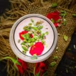 Rose Lassi is a delicious twist on the traditional lassi and is flavoured with rose syrup to give it a nice pink hue and a refreshing taste. It is a perfect drink to serve for breakfast or for evening snack. Here is how to make rose lassi recipe.