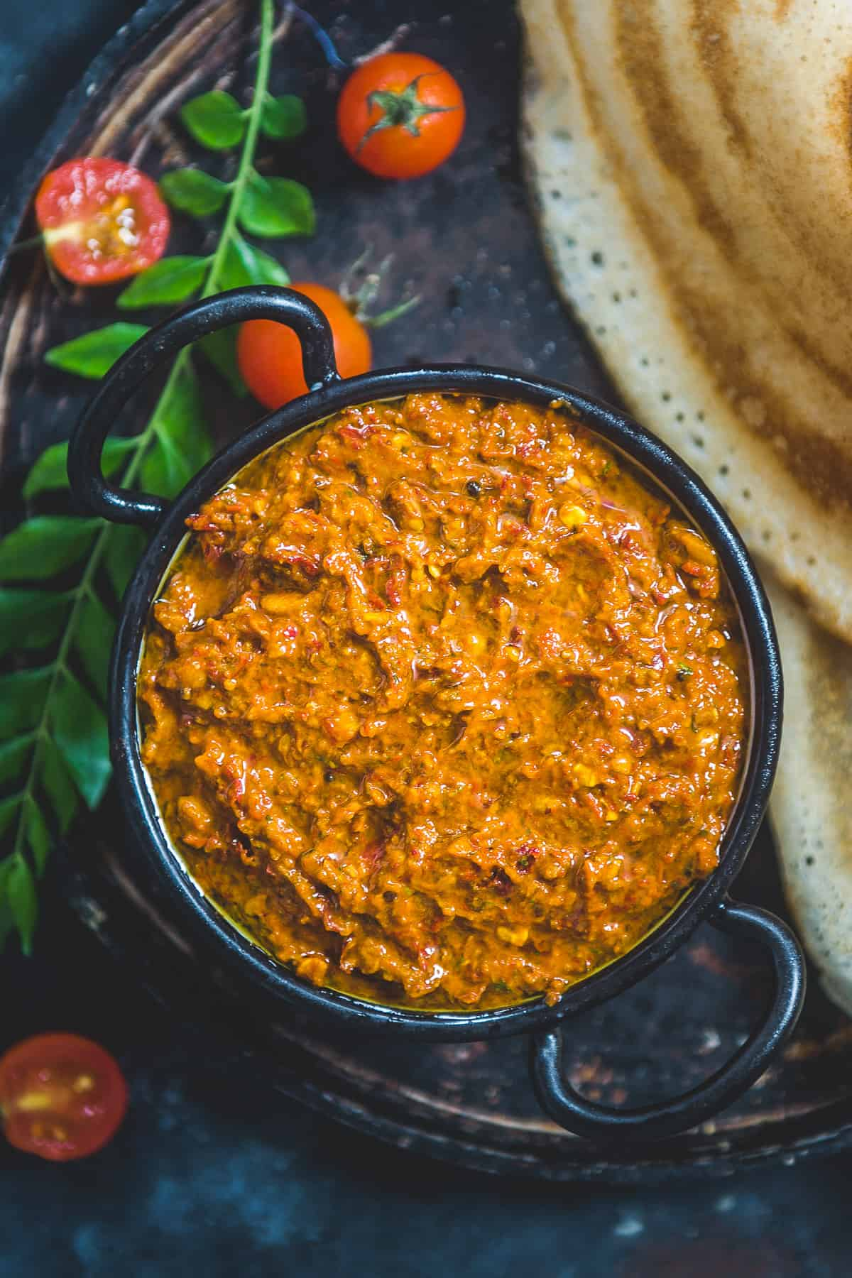 Tomato pachadi served in a bowl.