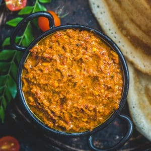 This Spicy and tangy Tomato Pachadi is a delicious Andhra style tomato chutney recipe. It goes well with South Indian breakfast dishes such as idli, uttapam, dosa and even appams.