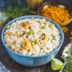 Upma is a delectable South Indian breakfast dish. Rava Upma is made by continuously stirring roasted semolina (Sooji) with spices, veggies, green chillies and curry leaves on a medium flame with hot water. Sprinkle lemon juice on it and enjoy it hot. It makes for a great lunch box option as well. Here is how to make Upma Recipe (Step by Step).