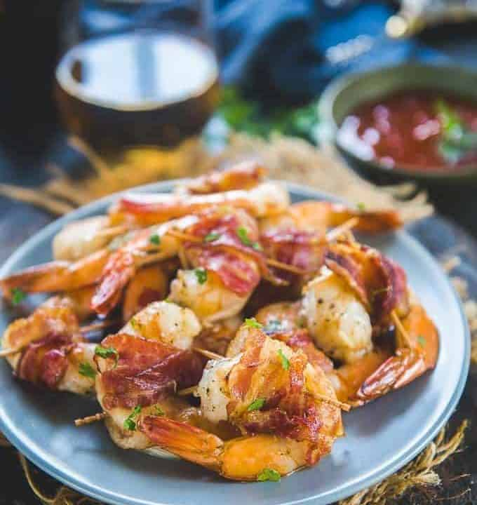 Bacon wrapped shrimp served on a plate.