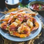 These Bacon Wrapped Shrimp are a super easy appetizer recipe which are a party favourite and can be made in no time. Crispy bacon wrapped over juicy shrimps makes these a crowd pleaser. Here is how to make grilled shrimp wrapped in bacon.