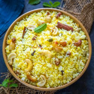 Basanti Pulao or sweet yellow rice is a traditional Bengali recipe made especially for festivals or special occasions. Made using Gobindobhog rice, turmeric, and saffron, this golden sweet rice is a delight to eat. Here is how to make it.
