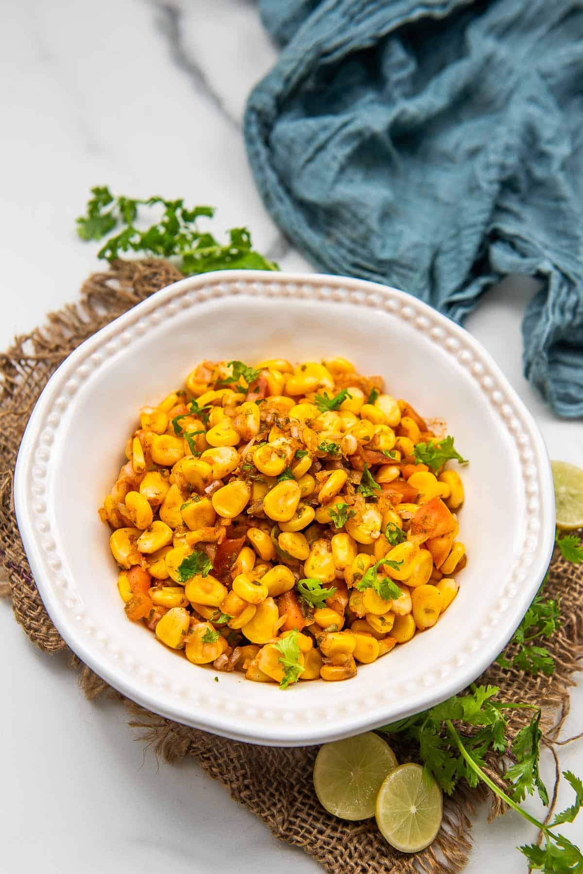 Indian style corn chaat served in a bowl.
