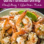 Soothingly textured on the outside and tender on the inside, that's baked Garlic Parmesan Shrimp for you all! They have this creamy, juicy coating of garlic and cheese and the lemony tang from the generous drizzle of lemon. Anybody who loves shrimp HAS to try this easy shrimp recipe first thing! #Fish #Seafood