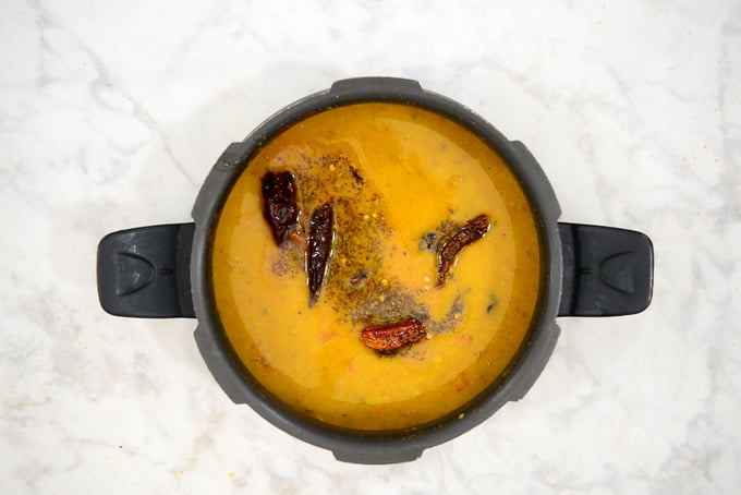 Tempering poured over dal.