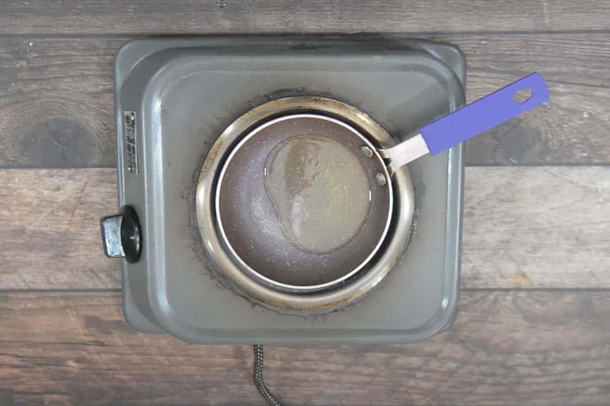 Ghee heating in a pan.