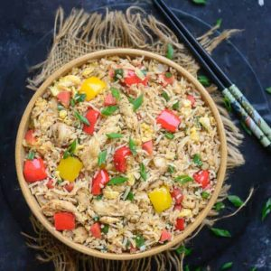 This Chicken Fried Rice is just like the Chinese restaurant you visit in your neighbourhood. Make this Homemade, Chinese style rice using my simple and easy recipe. Here is how to make Chicken Fried Rice Recipe at home.