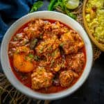 Bengali Kosha Mangsho or Mutton Kasha is a delicious spicy Bengali Mutton Curry that is full of flavors from mutton, spices, and mustard oil. Here is how to make it.