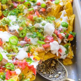Loaded Nachos served in the tray.