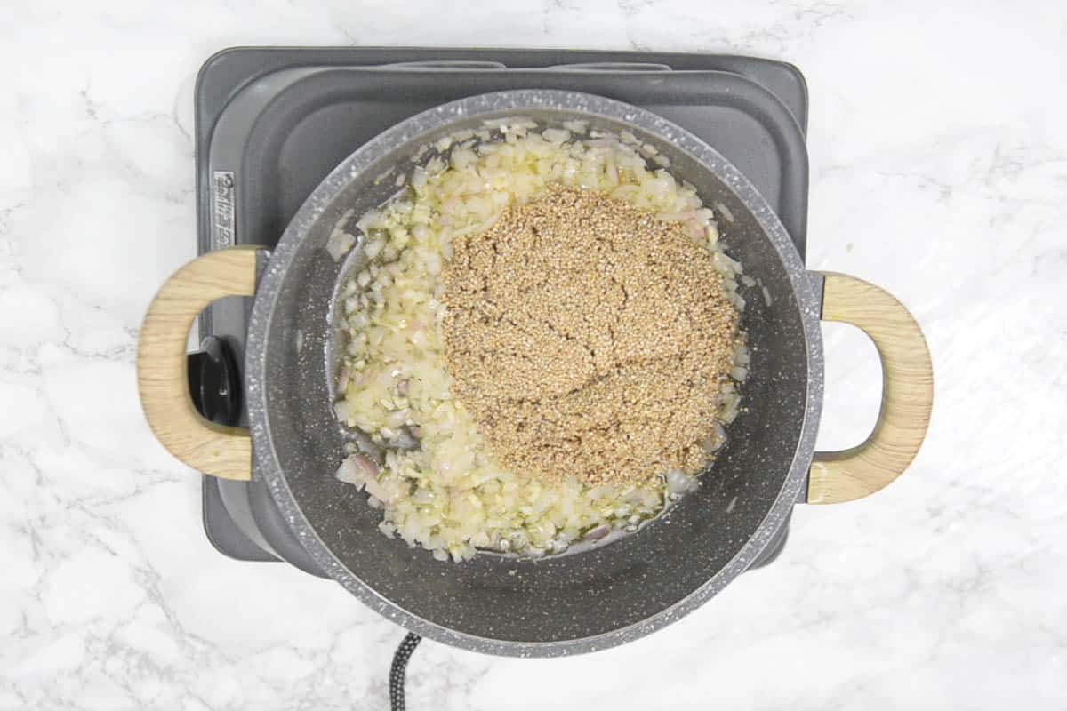 Rinsed quinoa added in the pan.