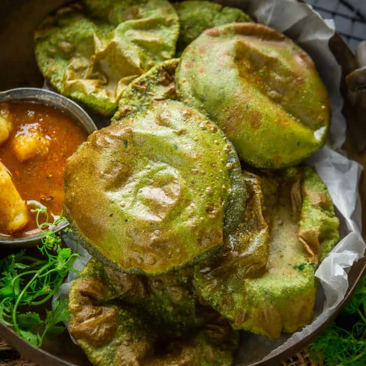 Palak Puri is a colorful variation of usual puffed Puris where spinach puree is added in the dough. This crispy puri can be eaten as it is and you could even serve it with a sabzi for breakfast.